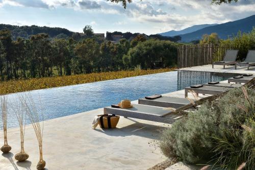 The swimming pool at or near Domaine de Peretti della Rocca