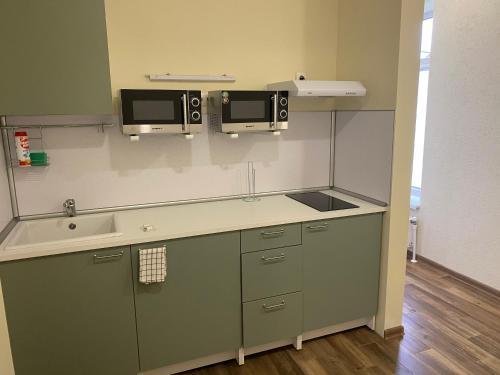 Кухня или мини-кухня в Apartments Rassvet