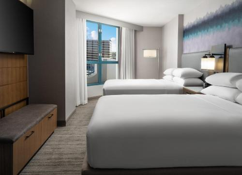 A bed or beds in a room at Costa Mesa Marriott