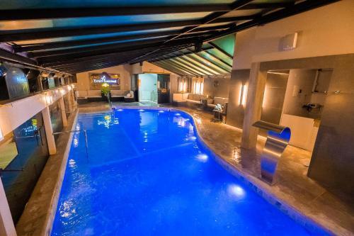 The swimming pool at or near Hotel Rouxinol