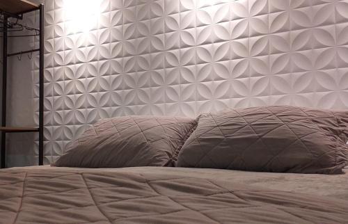 A bed or beds in a room at Apartamento Bela Vista