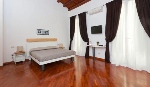 A bed or beds in a room at B&B Ai Tintori