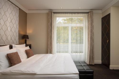 Łóżko lub łóżka w pokoju w obiekcie Modrzewie Park Hotel & SPA