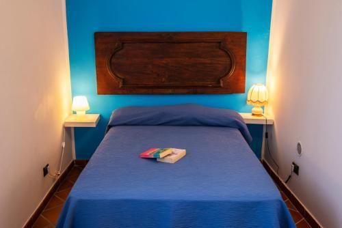 Letto o letti in una camera di Torre Caetana