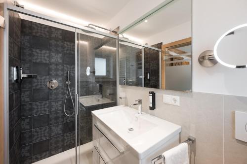 Un baño de Hotel Alpenhof
