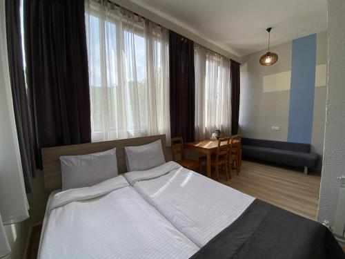 A bed or beds in a room at Popock Dilijan 1