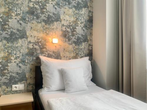 Кровать или кровати в номере Hotel Abácie & Wellness