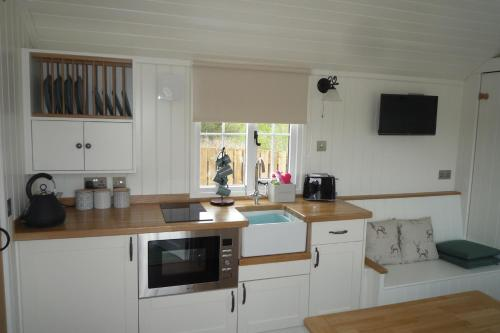 A kitchen or kitchenette at Foresterseat