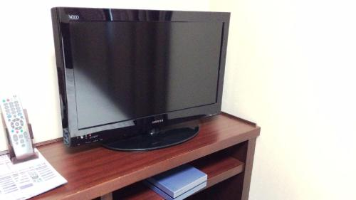 A television and/or entertainment center at Dormy Inn Akita