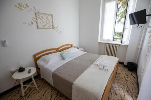 A bed or beds in a room at Villa Sant'Anna