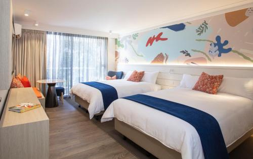 A bed or beds in a room at Sea World Resort