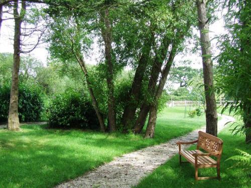 A garden outside Les Gites de la Laiterie de Tocqueville