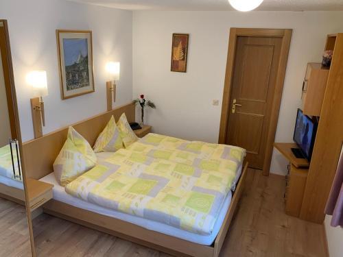 Кровать или кровати в номере Alpenblick Superior