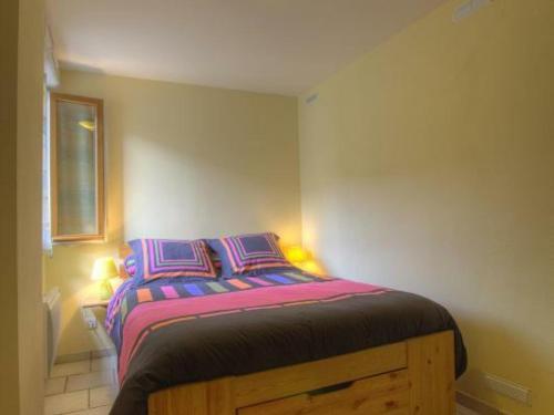 Un ou plusieurs lits dans un hébergement de l'établissement Gîte Mijoux, 3 pièces, 6 personnes - FR-1-493-151