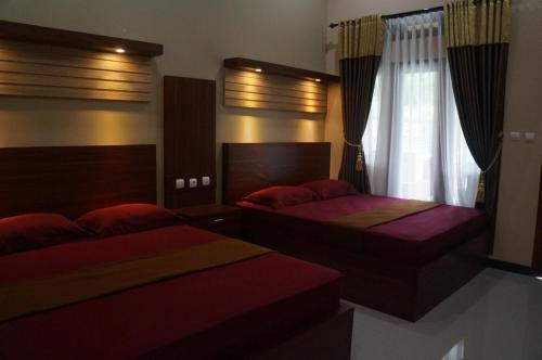 A bed or beds in a room at Rivana batukaras