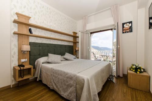 A bed or beds in a room at Splendid Hotel Taormina