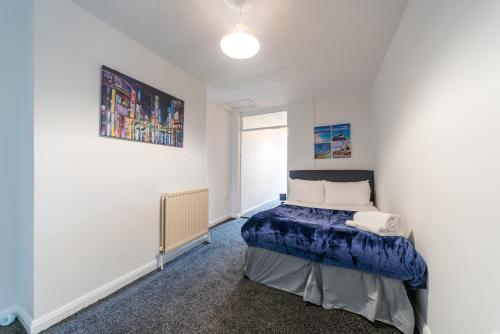A bed or beds in a room at Favour Spacious Inn By JESOUTH