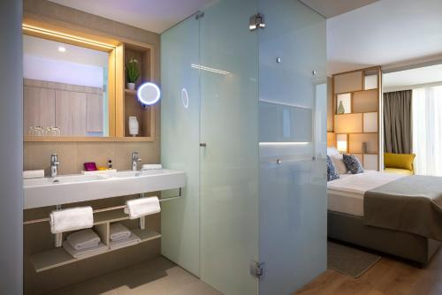 A bathroom at Valamar Parentino Hotel - ex Zagreb