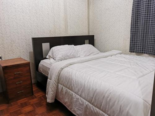 A bed or beds in a room at Apartemen Cibubur Village by ARSAKHA PROPERTY