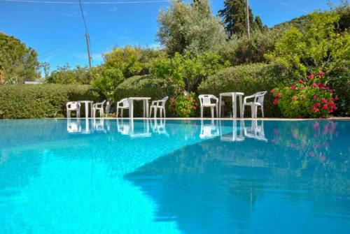 The swimming pool at or near Moulinos Studios