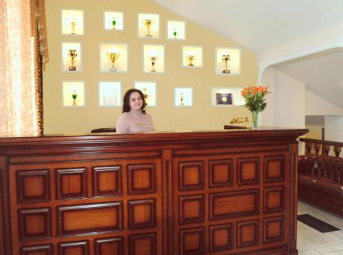 Лобби или стойка регистрации в Бизнес Отель Спорт