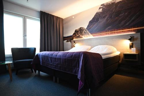 A bed or beds in a room at Comfort Hotel Umeå City