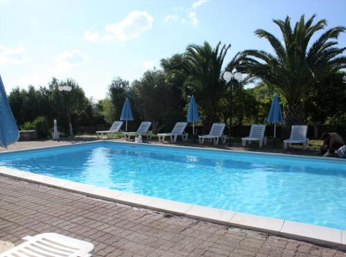 The swimming pool at or near Drosia - Chic & Classic Rooms