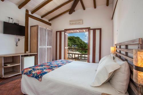 A bed or beds in a room at Pousada Refugio da Harmonia