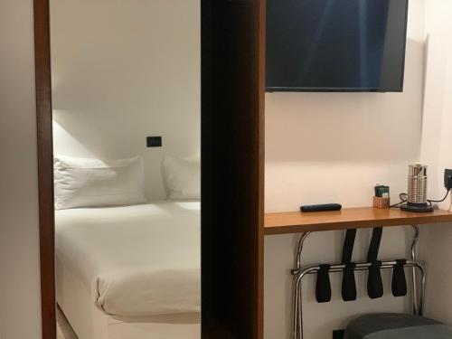 Letto o letti in una camera di Albergo Delle Regioni, Barberini - Fontana di Trevi