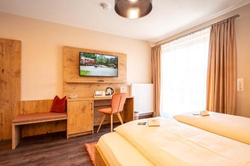 Ein Bett oder Betten in einem Zimmer der Unterkunft Boutique Hotel Angerer