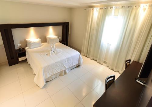 Cama ou camas em um quarto em Hd Park Hotel