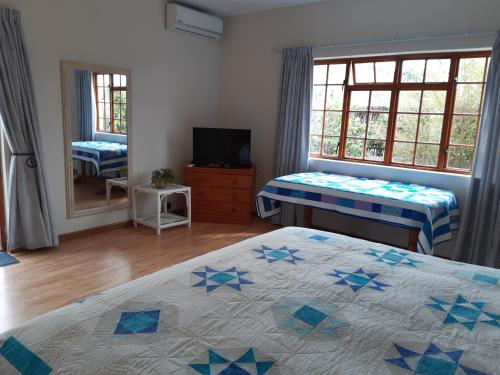 A bed or beds in a room at Happy Jackal Guest House