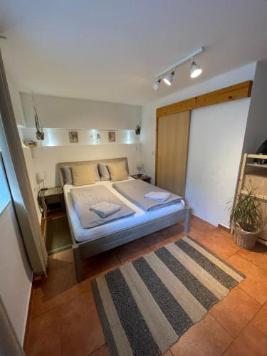 Ein Bett oder Betten in einem Zimmer der Unterkunft Gästehaus Stefan Koch