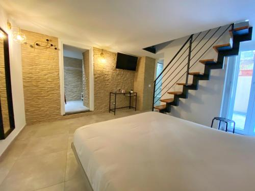A bed or beds in a room at B&B Salerno IN Centro