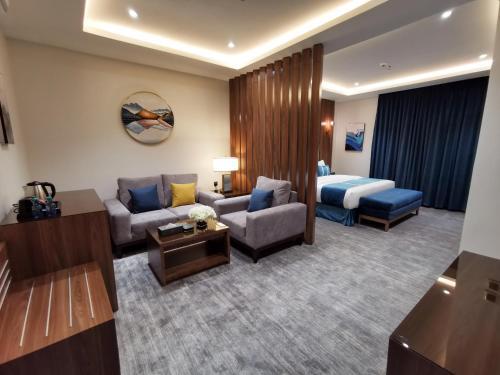 A seating area at كيان للأجنحة الفندقية