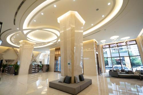 The lobby or reception area at HE TI Hotel
