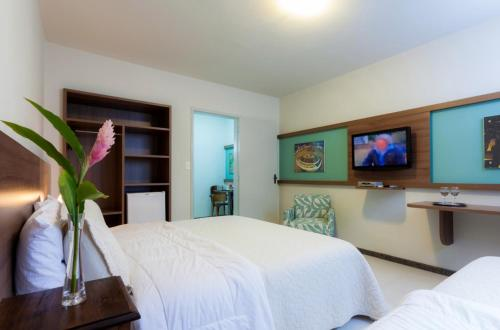 A television and/or entertainment center at Hotel Tavares Correia