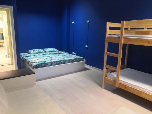 A bunk bed or bunk beds in a room at ХОСТЕЛ НА КОММУНИСТИЧЕСКОЙ
