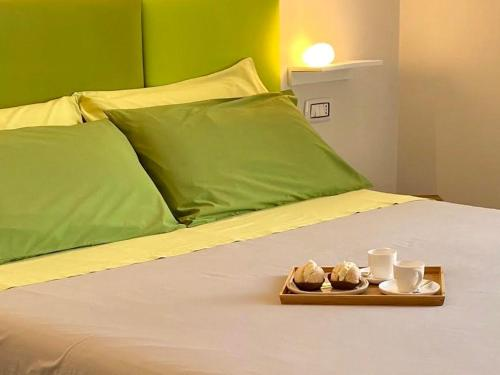 A bed or beds in a room at Centro storico via Sassari Accommodation