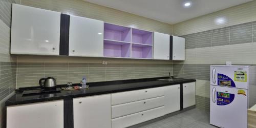A cozinha ou cozinha compacta de Rose Al Salam Hotel