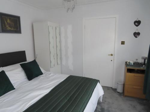A bed or beds in a room at Barrhill Woods B&B