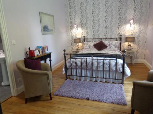 Un ou plusieurs lits dans un hébergement de l'établissement La Maison Ribotteau
