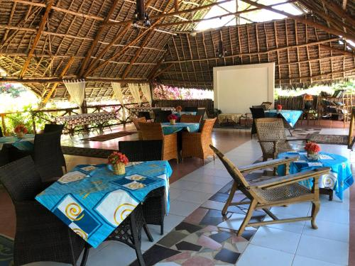 A restaurant or other place to eat at Tamani Villas - Annex