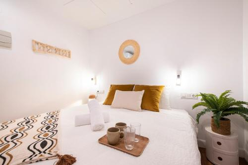 A bed or beds in a room at Marisol Guesthouse