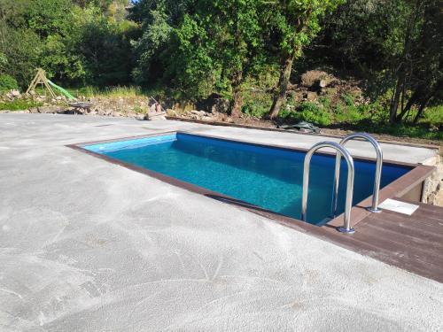 The swimming pool at or near Casa o Leiteiro