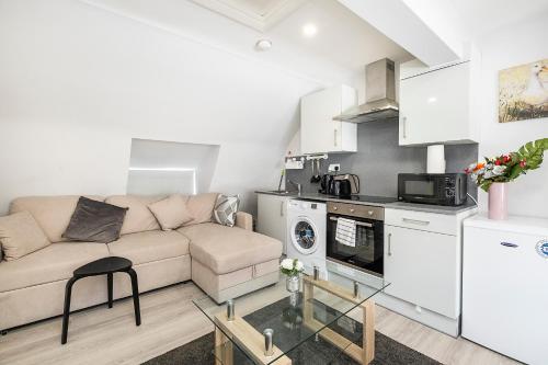 A kitchen or kitchenette at Securematics Superior Studio Apartments