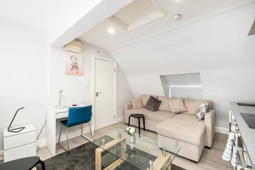 A seating area at Securematics Superior Studio Apartments