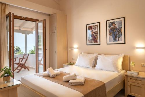 A bed or beds in a room at Krioneri Beach
