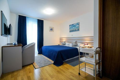 Krevet ili kreveti u jedinici u objektu Hotel Belvedere