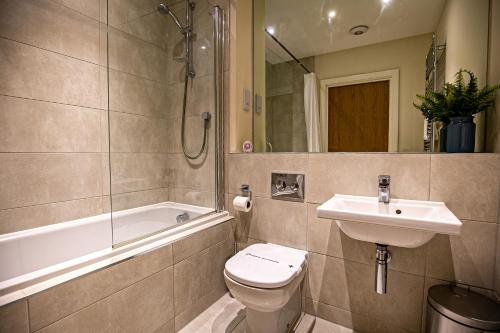A bathroom at North Court Watford by Stay Shoal